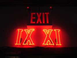 Red Neon IX XI under Exit Sign